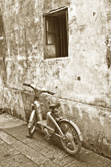 Old bike in front of a house