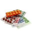 Tabletten auf Geldscheinen