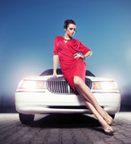 Fototapety Sexy lady in front of a limousine
