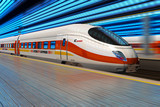 Fototapety High speed train departs from railway station with motion blur
