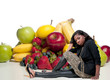 Woman Sitting with Assorted Fruits