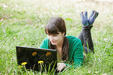 young sexy girl relaxing with laptop