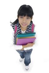 adorable girl with backpack holding a book