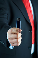 Businessman offering USB pen drive