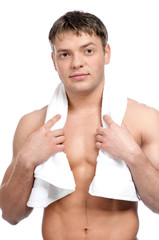 A young man with a towel