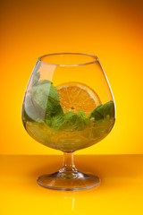 Glass with mint and orange drink