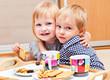 Cute children are eating dessert
