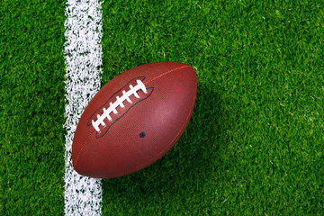 American football on grass from above.