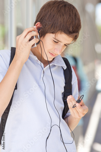 Boy with MP3 player outdoors