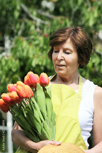 Senior woman holding gardening