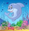 Happy dolphin at sea bottom 2