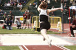 "Female athlete competing on the ""long jump"" event"