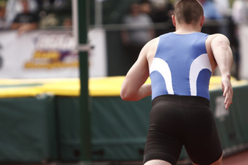Male athlete competing in the High Jump event