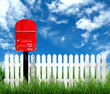 red postbox with white fence