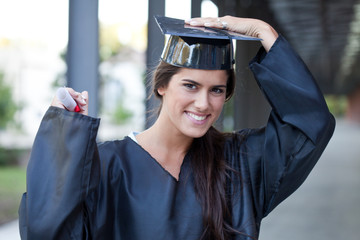 Happy graduate holding her diploma