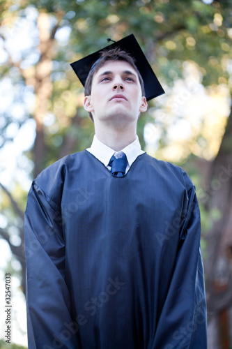 Serious graduate outdoors