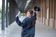 Happy graduate holding mortarboard and diploma