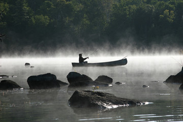 Fishing From a Canoe on a Misty Morning - Ontario, Canada