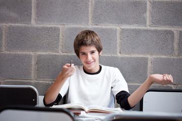 Impish schoolboy in classroom