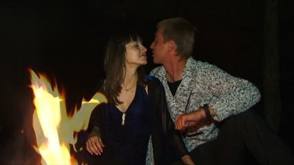 Romantic kiss near the fire