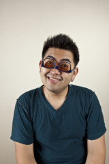 upside down, A man wearing eyeglass upside down, funny face.