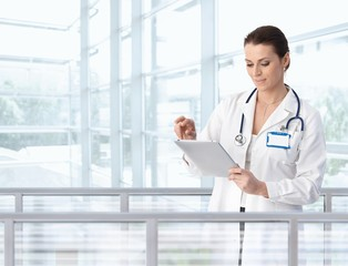 Female doctor using tablet in hospital