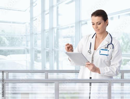 Female doctor using tablet in hospital