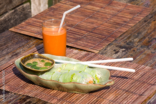 Carrot juice and vegetarian rolls