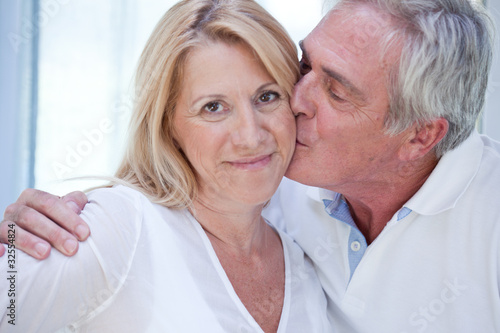 Senior man kissing wife