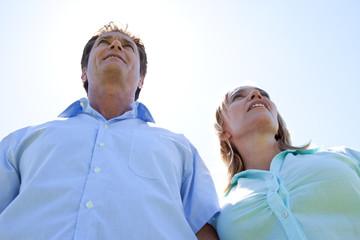 Mature couple under blue sky