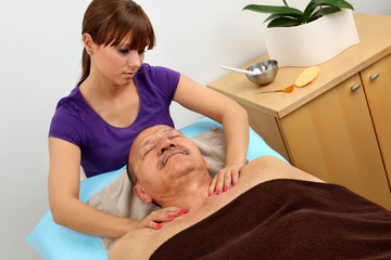 older man receiving professional massage