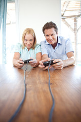 Mature couple playing video game