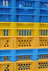 blue and yellow crates stacked