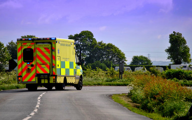 Ambulance on a country lane approaching a bend