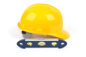 yellow industrial safety helmet and water level
