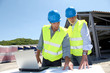 Industrial people working on building site