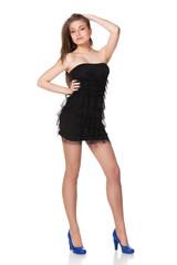 Full-body portrait of fashion model in black cocktail dress