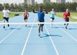 Runners On A Race Track At Finish Line