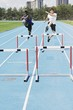 Woman Jumping Hurdles On A Track