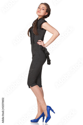 Portrait of young female in coverall isolated on white