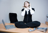 Businesswoman sitting on the desk and listening music