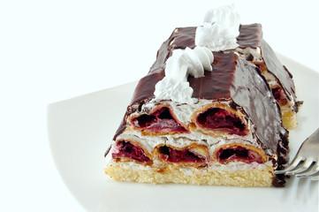 piece of cake with chocolate glaze