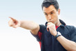Football referee blowing whistle and pointing finger