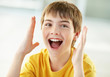 Closeup of a cheerful little boy shouting