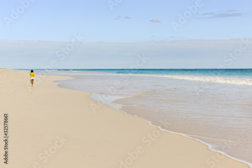 Woman jogging along the Pink Sands Beach on Harbour Island