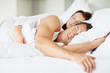 Attractive young couple sleeping together