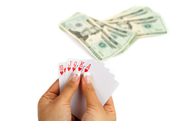 Royal poker in female hand with money background