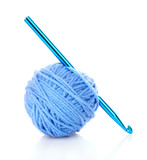 Crochet hook and wool ball isolated on white