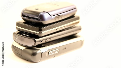 Mobile phone pile rotating on white background