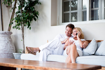 Mature couple with cell phone on couch
